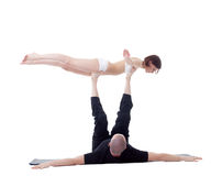 Man and girl doing yoga in studio. Bird Pose. Stock Photography