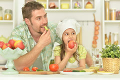 Man and girl eating stock photography