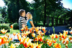 Man and girl among flowers Stock Photography