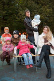 Man and girl with group of five children in autumn Royalty Free Stock Photos