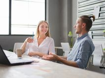 The man and the girl have a break in office work stock photos