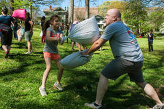 Man And Girl Hit Each Other In Outdoor Pillow Fight Stock Photography