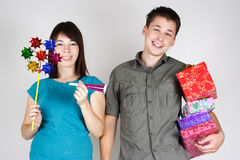 Man and girl holding many gifts and smiling Stock Images