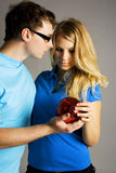 Man and girl holding red ball Stock Photography