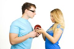 Man and girl holding red ball Stock Photo