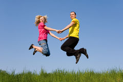 Man and girl jumping Royalty Free Stock Photos
