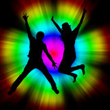 Man and Girl Jumping with Colorful Background Royalty Free Stock Image