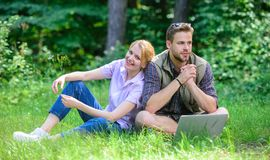 Man and girl looking for inspiration in nature. Inspiring environment. Couple youth spend leisure outdoors working with. Laptop. Modern technologies give royalty free stock photos