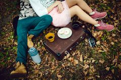 A man and a girl lying on a blanket on a winter picnic on Valentine`s day in the woods and drink tea. Top view, flat layout stock photos