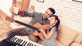Man and Girl Make Selfie with Musical Instruments. royalty free stock photo