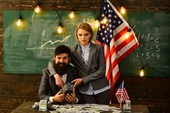 Man and girl with money and United States flag on green background. royalty free stock photo
