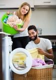 Man and girl near washing machine Stock Photos
