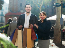 Man and girl with purchases at street Stock Image