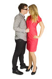 Man and girl in red dress standing and embracing Stock Photos