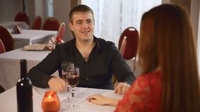 Man and girl in restaurant  rendezvous romantic evening candles wine Valentine's Day. Man  and girl in restaurant  rendezvous romantic evening candles wine stock video footage