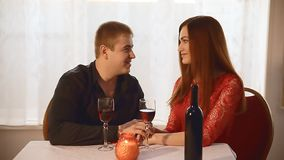 Man and girl in restaurant  rendezvous romantic Valentine's Day evening candles wine. Man  and girl in restaurant  rendezvous romantic Valentine's Day evening stock video