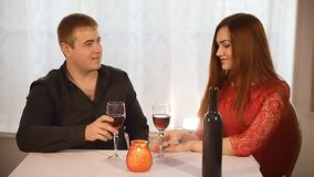 Man and girl in restaurant  rendezvous Valentine's Day romantic evening candles wine. Man  and girl in restaurant  rendezvous Valentine's Day romantic evening stock footage
