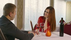 Man and girl romantic evening love woman in restaurant drinking wine, Valentine's Day video 4K. Man and  girl romantic evening love woman in restaurant drinking stock footage