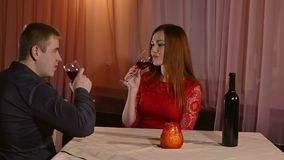 Man and girl romantic evening in restaurant drinking love woman kiss wine, Valentine's Day video 4K. Man and  girl romantic evening in restaurant drinking love stock footage