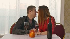 Man and girl romantic evening in restaurant drinking love woman wine, Valentine's Day video 4K. Man and  girl romantic evening in restaurant drinking love woman stock video footage