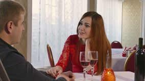 Man and girl romantic evening in restaurant love woman drinking wine, Valentine's Day video 4K. Man and  girl romantic evening in restaurant love woman drinking stock video
