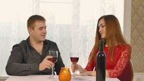 Man and girl romantic kiss evening in restaurant drinking love woman wine, Valentine's Day video 4K. Man and  girl romantic kiss evening in restaurant drinking stock footage