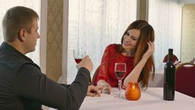 Man and girl romantic love woman evening in restaurant drinking wine, Valentine's Day video 4K. Man and  girl romantic love woman evening in restaurant drinking stock video