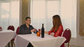 Man and girl romantic woman evening in restaurant drinking wine, Valentine's Day video 4K. Man and  girl romantic woman evening in restaurant drinking wine stock video footage