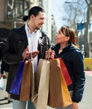 Man and girl with shopping bags at street Stock Photo