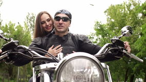 Man and a girl sitting on a motorcycle, close-up. stock footage