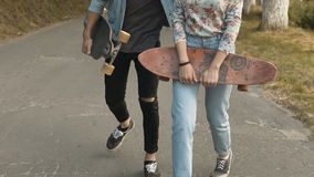 Man and Girl with Skateboards stock video footage