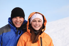 Man and girl in sport clothes standing and smiling Royalty Free Stock Photos