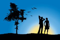 Man and girl standing on hill near tree Royalty Free Stock Image