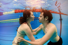 Man and girl in swimming pool Royalty Free Stock Photography