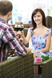 Man and girl with wine at cafe on a date Royalty Free Stock Images