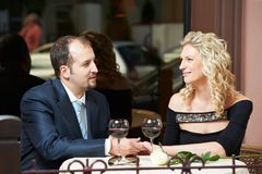 Man and girl with wine at cafe on a date Stock Photography