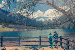 Man and girl with wooden terrace with lake and forest vintage co Stock Images