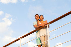 Man girlfriend cruise. Handsome young men standing with his girlfriend on cruise Stock Image