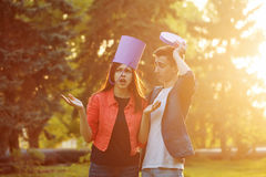 Man and girlfriend fooled. Date of teenagers. A guy and a girlfriend are fooling around with a gift box. Human faces are emotions Royalty Free Stock Images