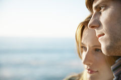 Man With Girlfriend By Ocean Looking Away Stock Image