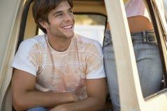 Man With Girlfriend Standing In Doorway Of Van Stock Image