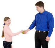Man give apple to the girl Royalty Free Stock Images