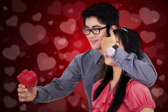 Man give a gift to his girlfriend Royalty Free Stock Image