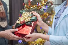 Man give present girl in party. Christmas and happy new year concept Royalty Free Stock Photography