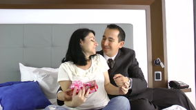 Man give to his wife a gift showing sign of family love.  stock video footage
