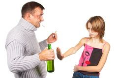 Man gives an alcohol to schoolgirl. Royalty Free Stock Images
