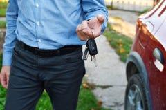 Man gives car keys royalty free stock photo