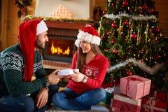 Man gives Christmas gift to girl Royalty Free Stock Image