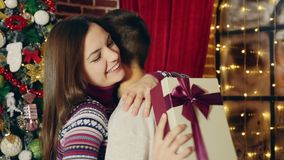Man gives Christmas gift stock video footage