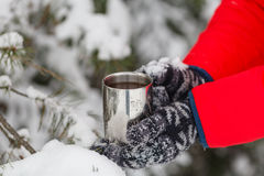 Man Gives Cup of Hot Tea or Coffee, Enjoying Cozy Snowy Winter M Royalty Free Stock Image